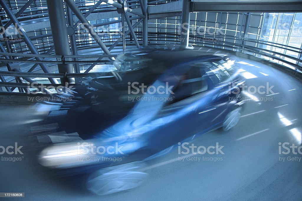 Small Blurred Blue Car in Parking Garage royalty-free stock photo