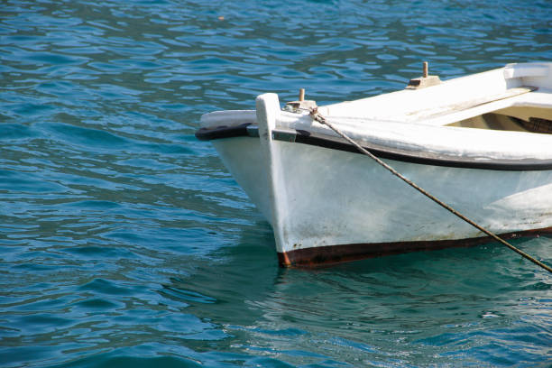 Small boat anchored stock photo