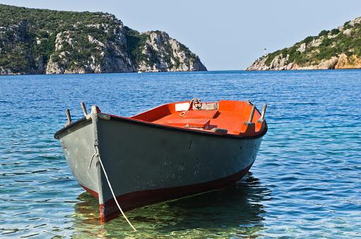 Small boat at sunny morning near Porto Koufo harbor