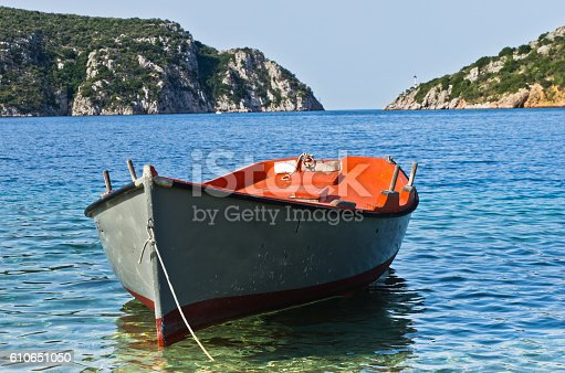 Small boat at sunny morning near the entrance to Porto Koufo harbor, Sithonia, Greece