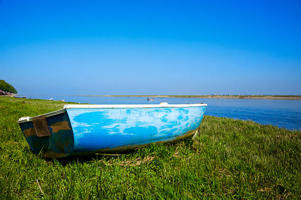 small boat at the shore of river Somme, Normandy, France small boat laying on the grass at the shore of river Somme, Normandy, France somme stock pictures, royalty-free photos & images