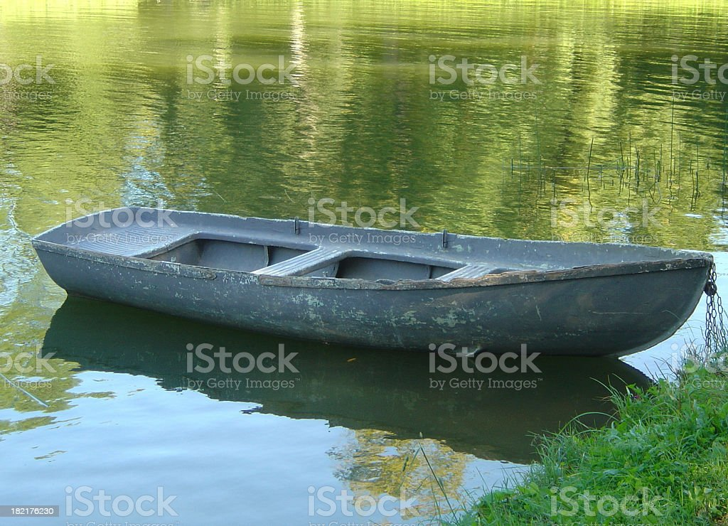 Small Boat Floating On A Pond royalty-free stock photo