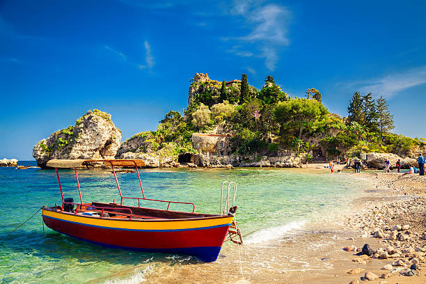 small boat for excursion small boat for excursion in front of the island Isola Bella at Taormina, Sicily sicily stock pictures, royalty-free photos & images