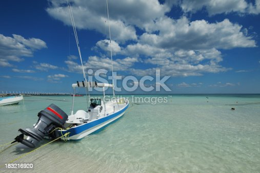 Small motor boat in shallow water on a Caribbean beach