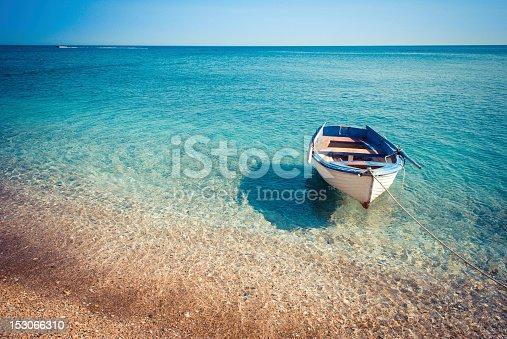 istock Small boat in the sea 153066310