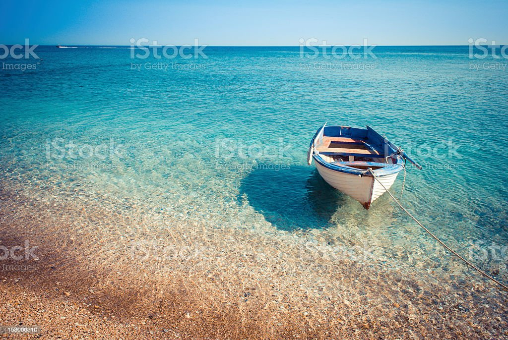 Small boat in the sea stock photo