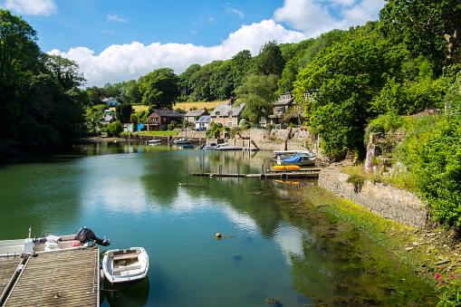 Small boat moorings at old fashioned Port Navas in the Helford Estuary