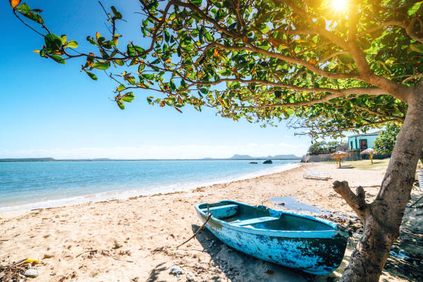 small boat of fishermen in gibara, cuba - cuba stock photos and pictures