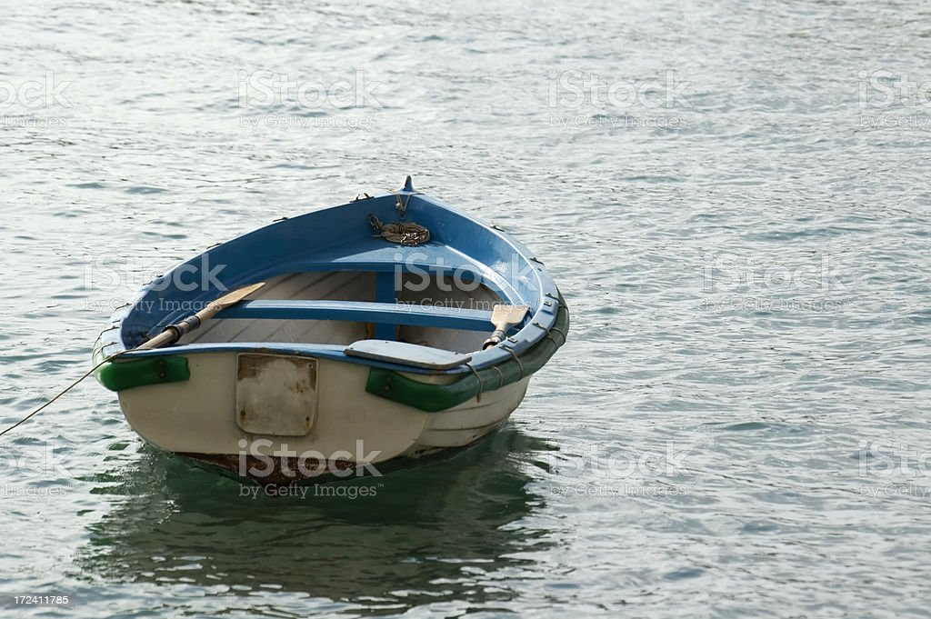 Small boat towards the sea royalty-free stock photo