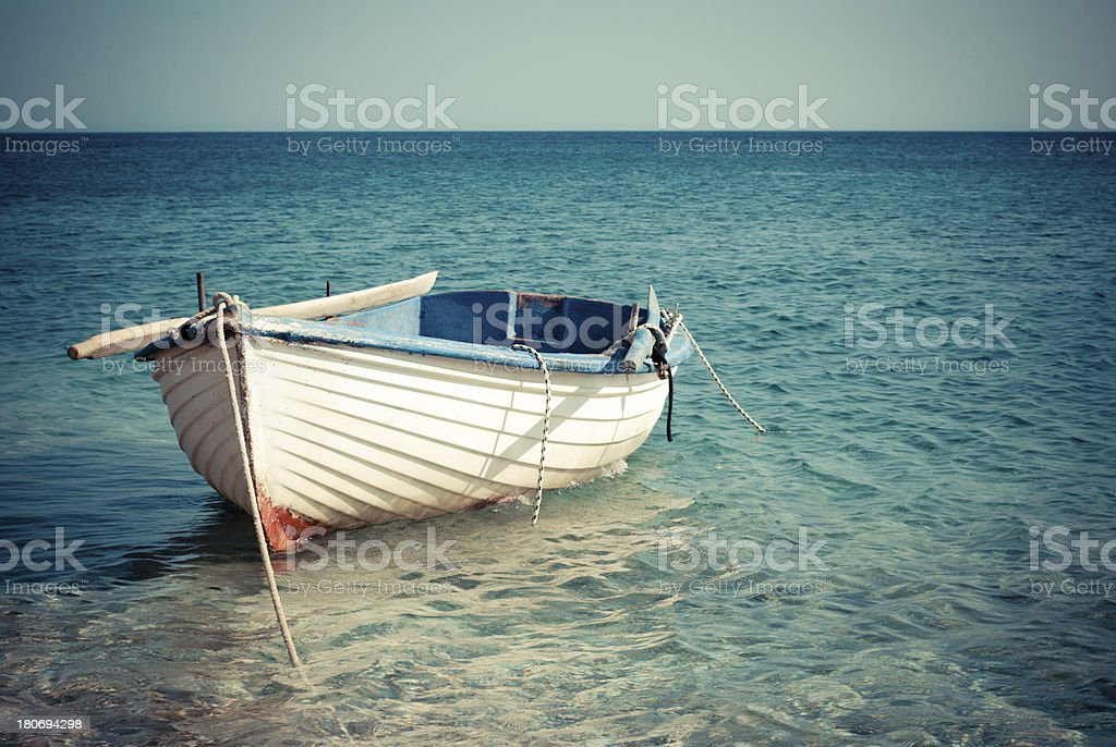 Small boat vintage style stock photo