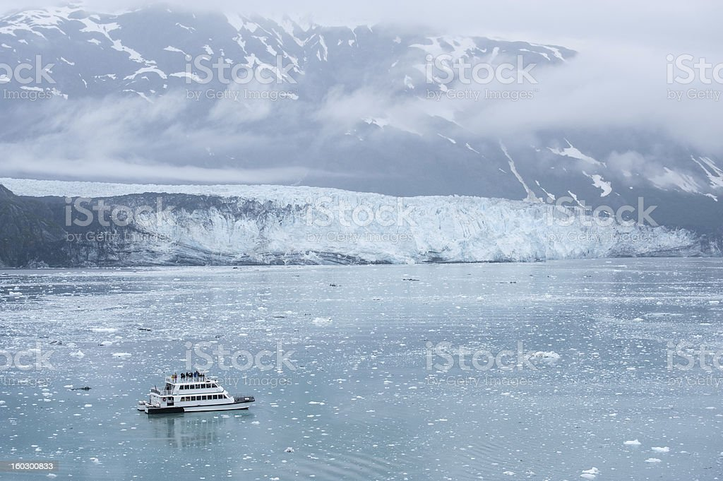 Small boat with tourists watching Hubbard Glacier. Alaska stock photo