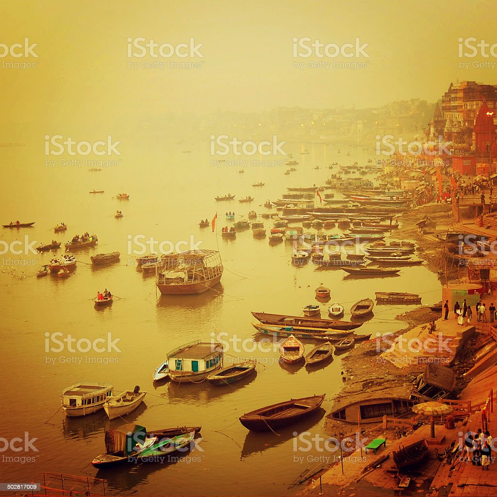Small boats at Ganga river vintage effect. Sunrise retro photo. stock photo
