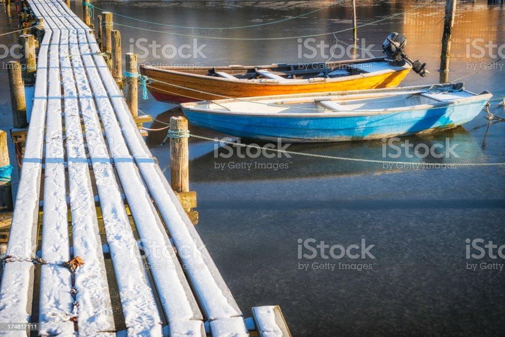 Small boats at winter jetty royalty-free stock photo