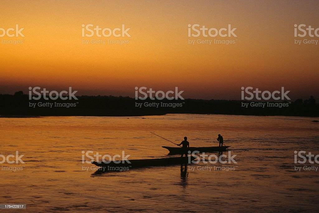 small boats on nepalese river stock photo