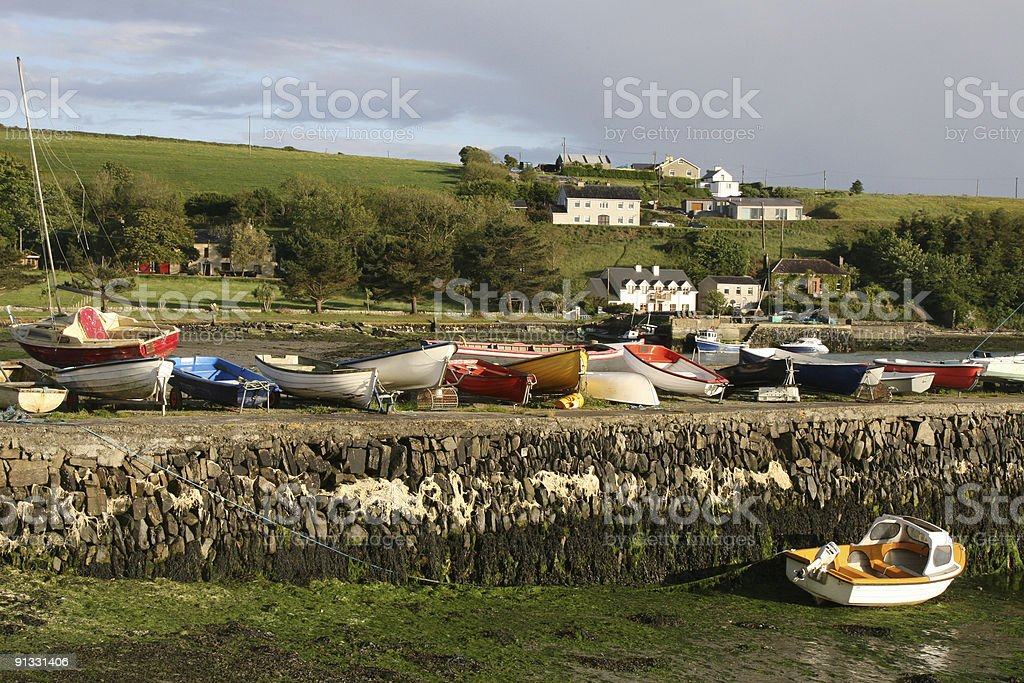 Small boats on  pier Ring, Near Clonakilty South West Ireland stock photo