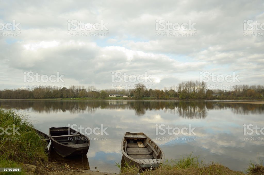 Small boats on the river Loire in France stock photo