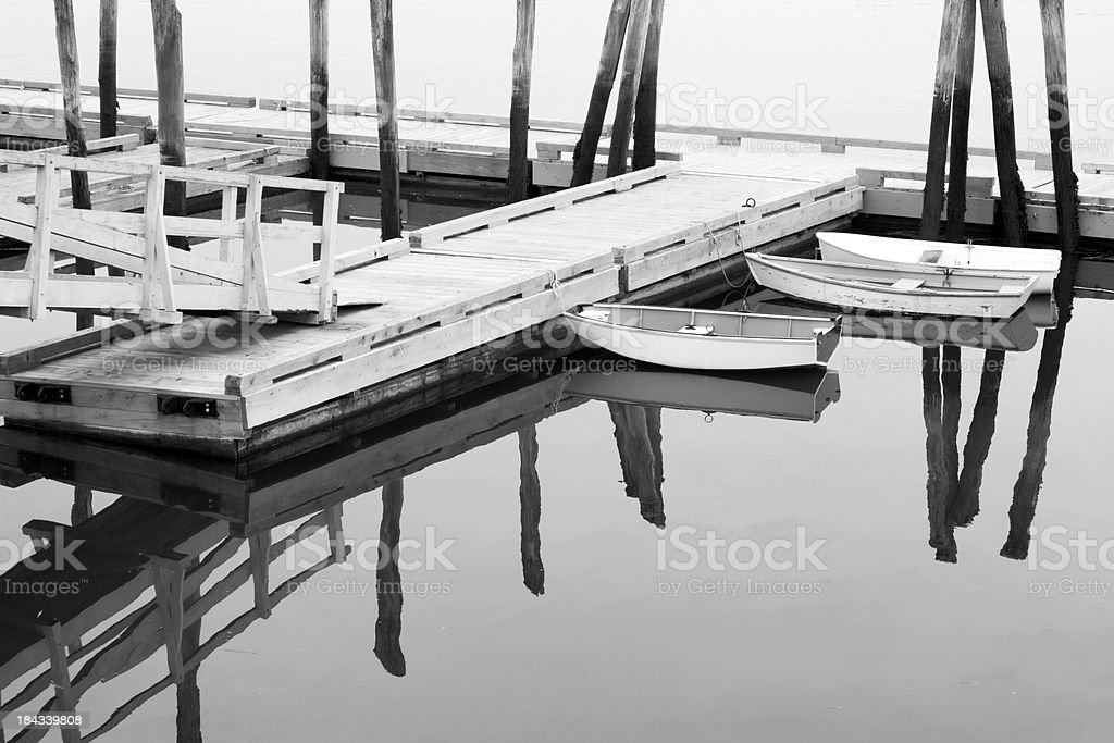 Small boats tied up to a dock royalty-free stock photo