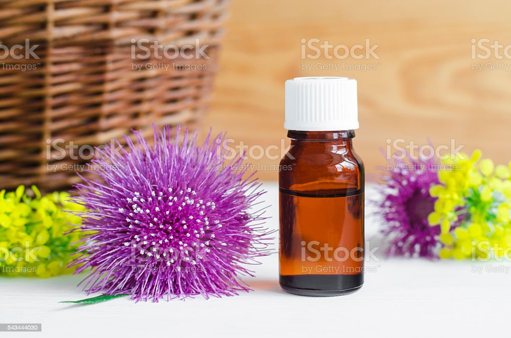 Small Bottle Of Burdock Extract Stock Photo - Download Image