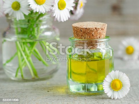 istock Small bottle of cosmetic chamomile oil 533351896