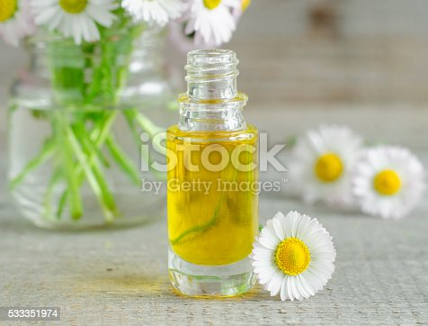 istock Small bottle of cosmetic chamomile oil 533351974