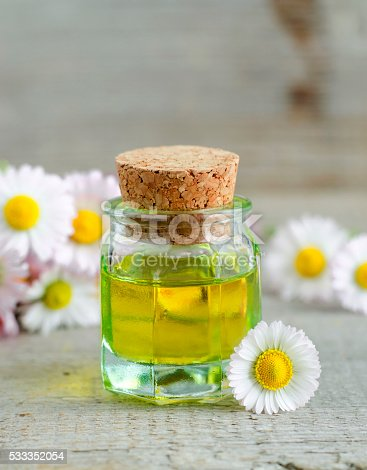 istock Small bottle of cosmetic chamomile oil 533352054