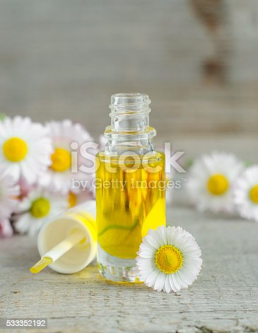 istock Small bottle of cosmetic chamomile oil 533352192