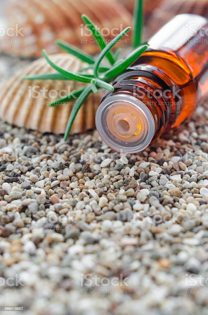 Small bottle of essential rosemary oil. stock photo