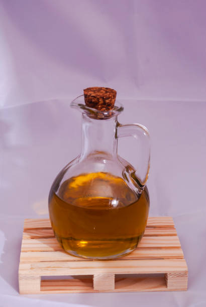 Small bottle of oil on a white background - foto stock