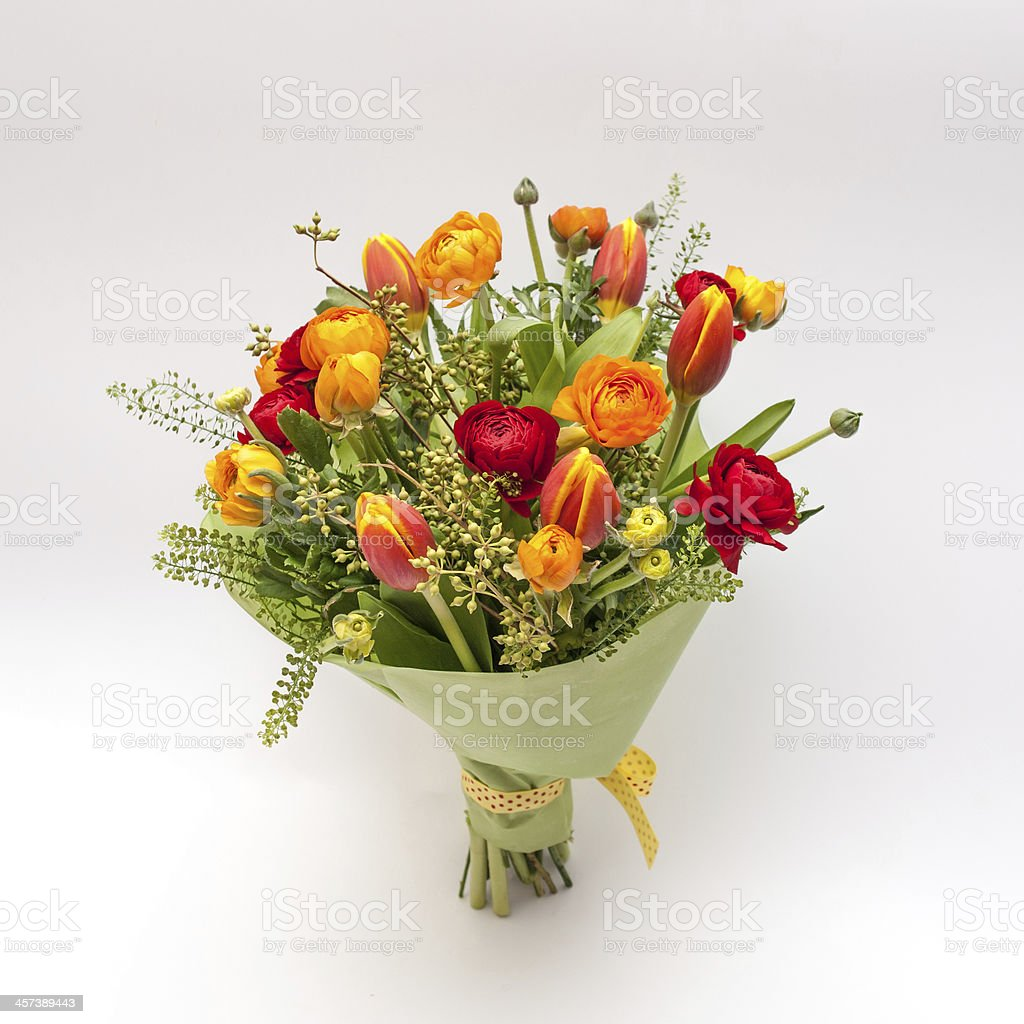 Small bouquet from ranunculus and tulips stock photo
