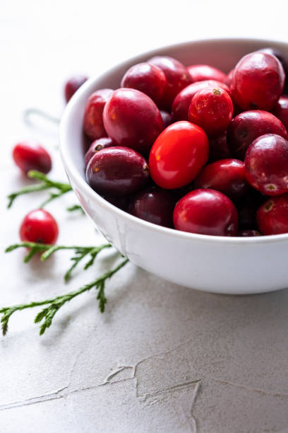 A Small Bowl of Fresh Cranberries on White stock photo