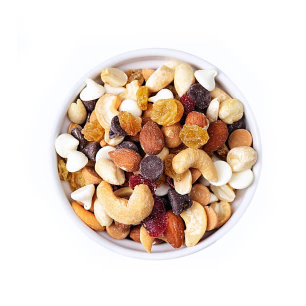 small bowl of trail mix - dried fruit stock photos and pictures