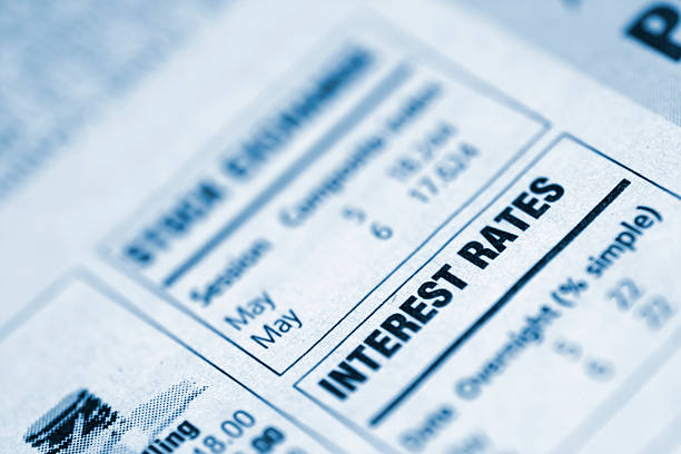 small box in a newspaper containing interest rates info - interest rate stock photos and pictures
