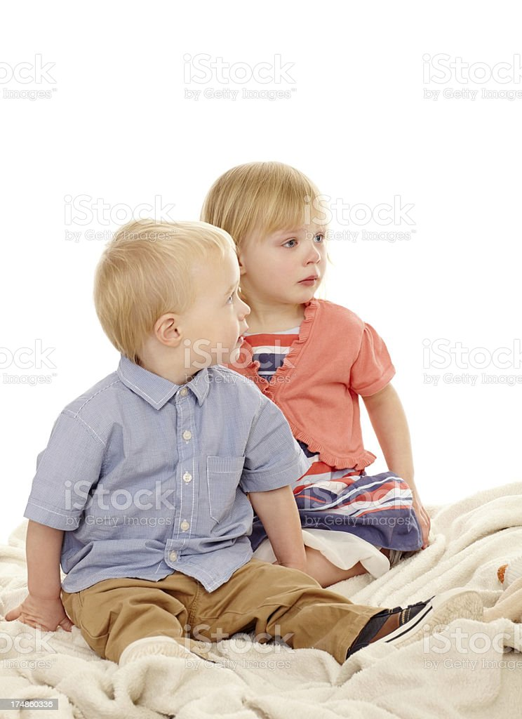 Small boy and girl looking away at something interesting royalty-free stock photo