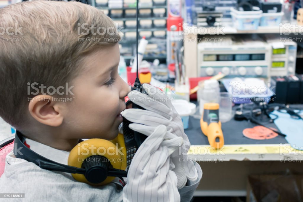 Small boy communicating over walkie talkie. stock photo
