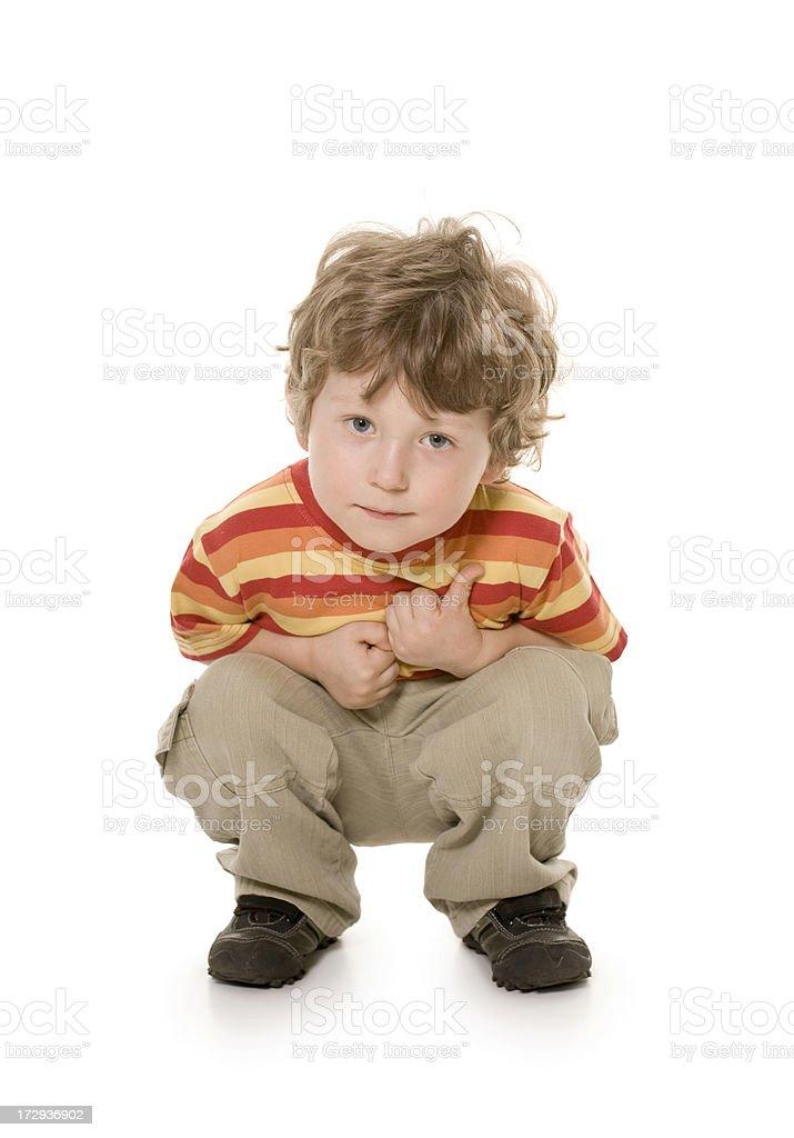 small boy crouching royalty-free stock photo