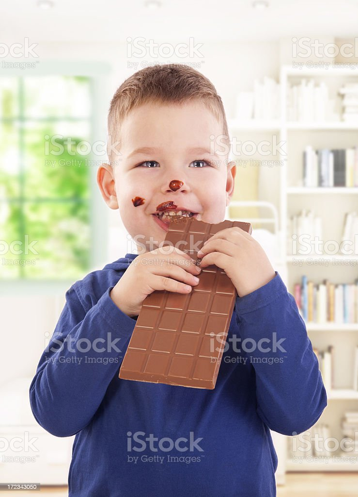 Small boy eating chocolate royalty-free stock photo