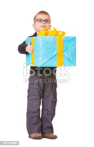 istock Small boy in spectecles with big present 162433681