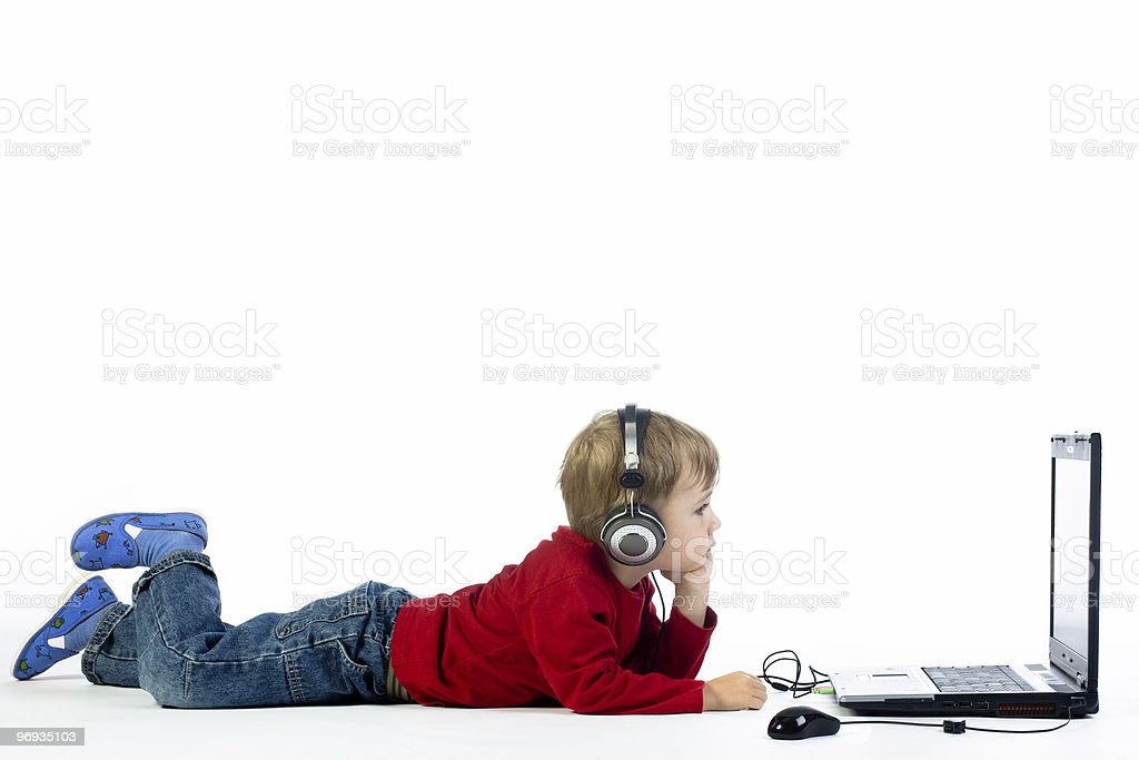 Small boy listening to music royalty-free stock photo