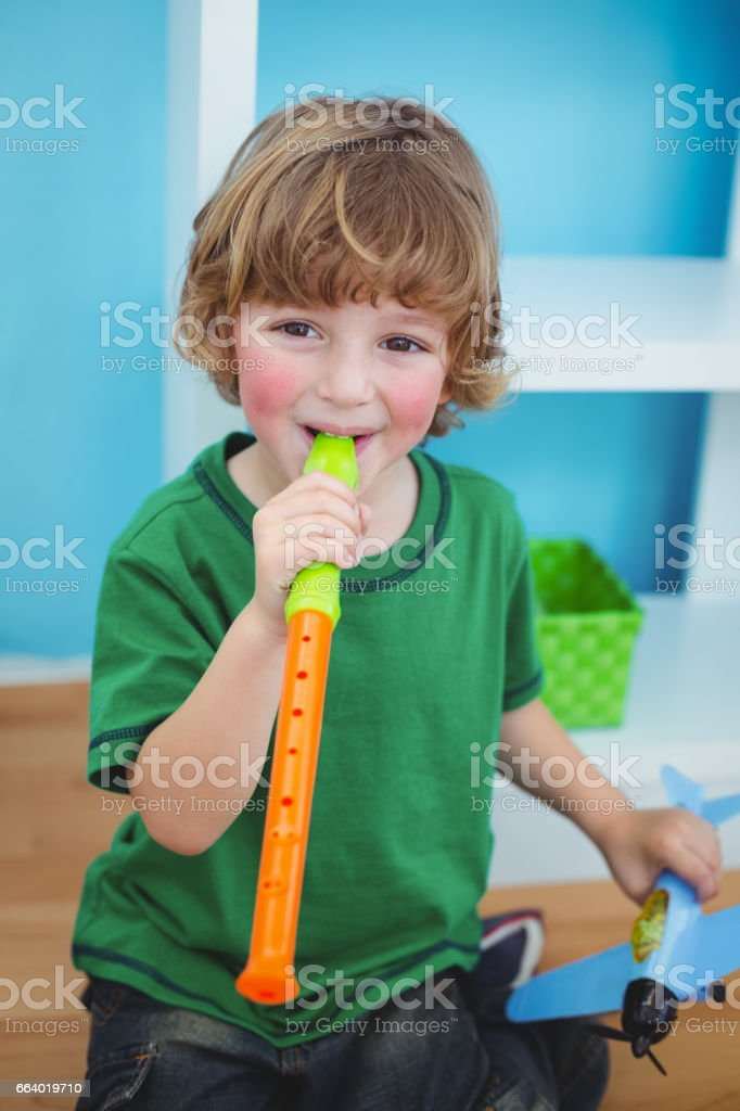 Small boy playing the flute stock photo