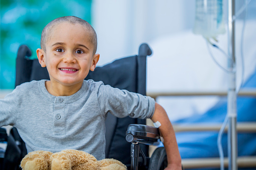 Small boy with cancer in wheelchair
