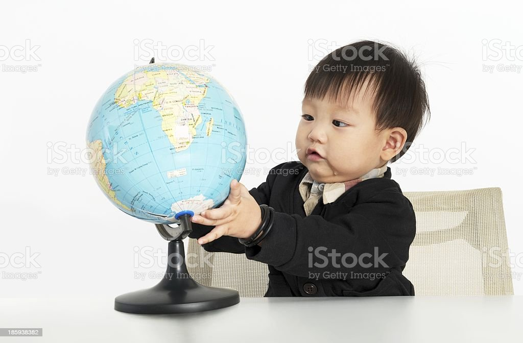 Small boy with globe royalty-free stock photo