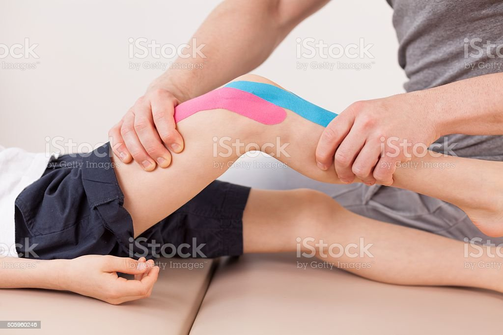 Small boy with kinesio tape stock photo