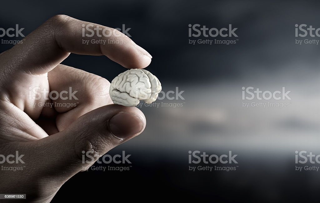 Small brain between fingers . Mixed media - Lizenzfrei Digital generiert Stock-Foto