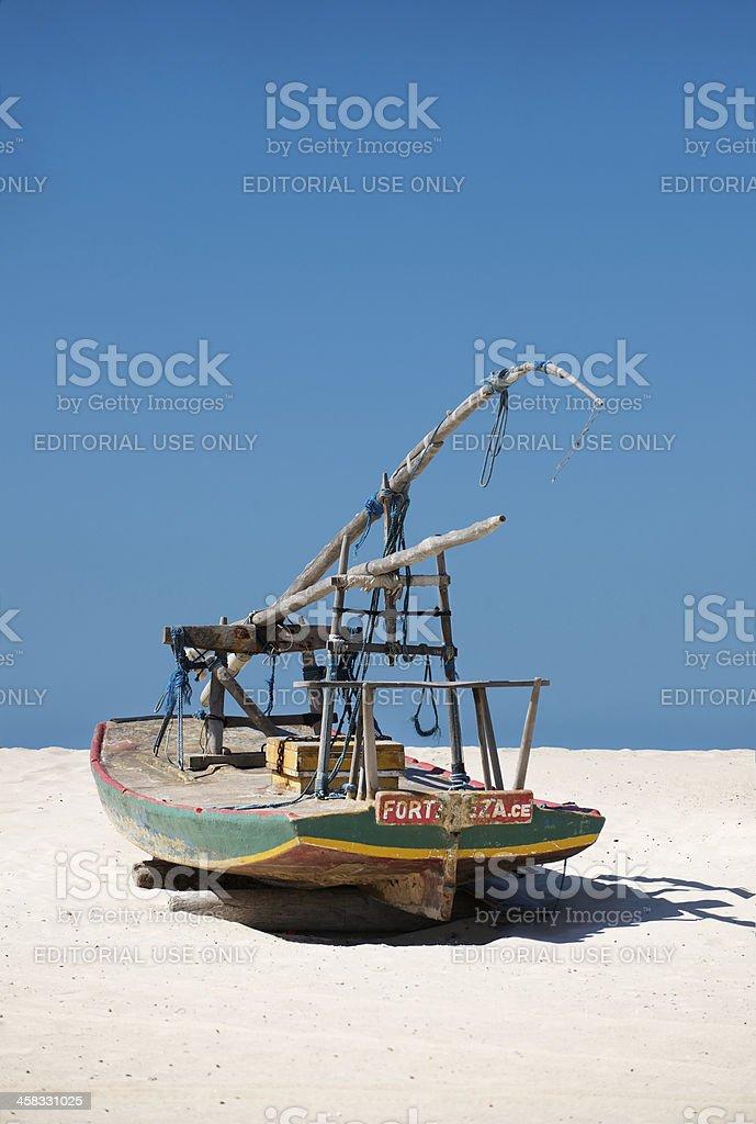 Small Brazilian fishing boat on beach royalty-free stock photo