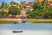 River side scene with boats in small Brazilian town.