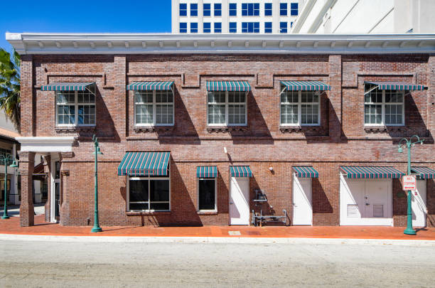 Small brick American commerce and offices two storied building stock photo