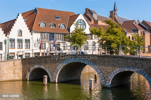 a quaint stone bridge in peaceful area far from busy tourist area of bruges