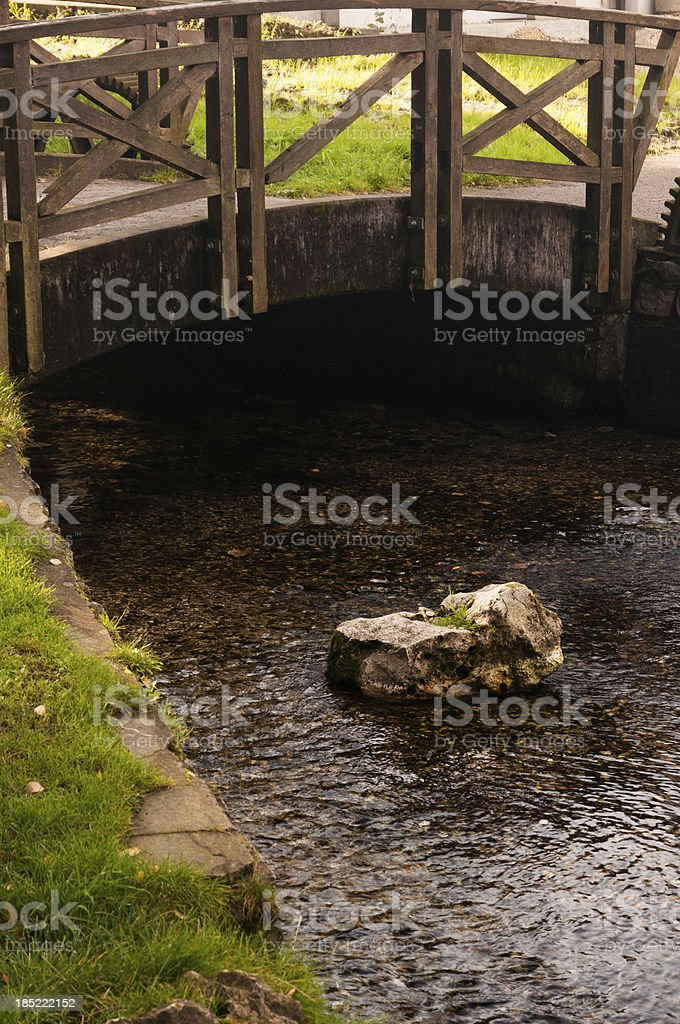 Small bridge over a creek royalty-free stock photo