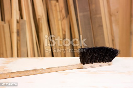 473158422 istock photo small broom on table at workshop 627399776