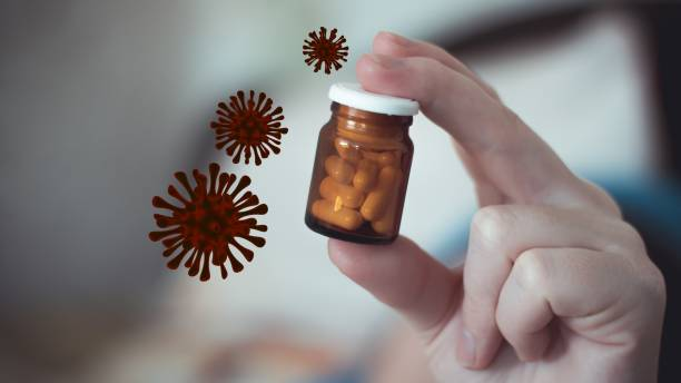 Small brown glass bottle with antibiotic pills in a female hand. The cure for the coronavirus influenza disease. 3d rendering dangerous flu strain cases stock photo